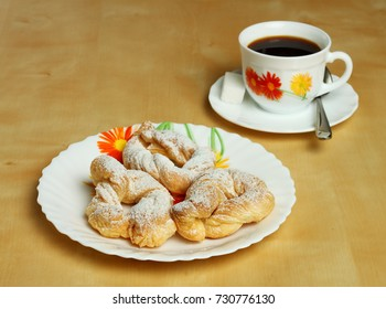 Cookies and a hot Cup of coffee with sugar on the table.
