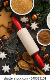cookies and ingredients for Christmas baking, vertical, top view, close-up