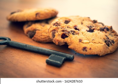 Cookies with a key to illustrate cookie banners for websites