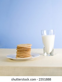 Cookies and milk on blue background