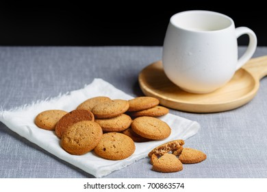 cookies and milk on gray cloth background