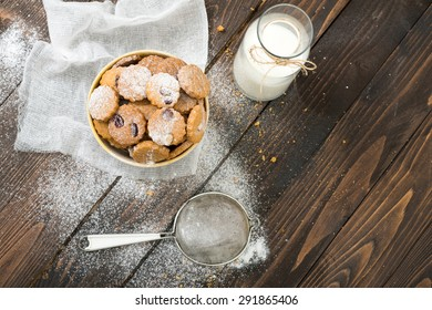 Cookies and milk on wooden table. Selective focus and small depth of field.