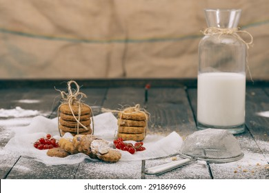 Cookies and milk on the wooden table. Selective focus and small depth of field.