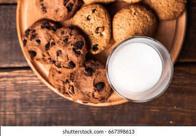 Cookies with milk and rustic wooden table