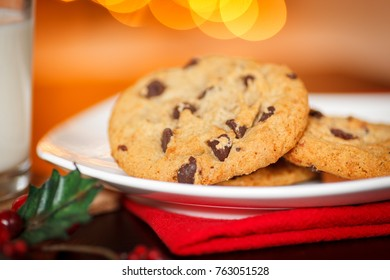 Cookies and Milk for Santa - Christmas tree & lights in background.
