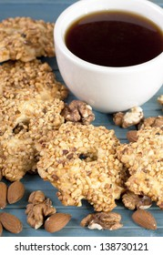 Cookies with nuts and a cup of tea.