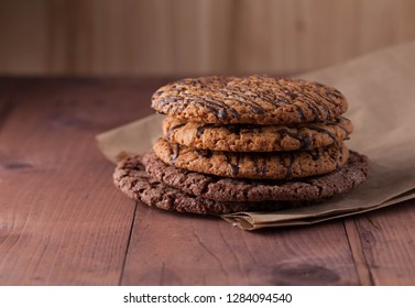 cookies on a brown paper on a wooden table. oatmeal cookies with chocolate lie on a wooden table