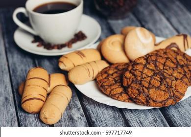 Cookies on a saucer coffee in a mug, turka for coffee