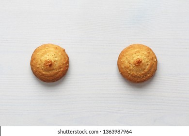 Cookies on a white background, similar to female nipples. Sexy nipples in the form of cookies. Humor, double meaning.