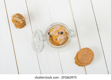 Cookies on white wooden table.