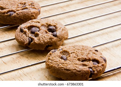 Cookies are on wooden boards.