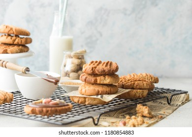 Cookies with peanuts butter and glass of milk on a concrete wall