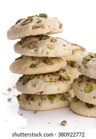 Cookies with pistachios and butter on a plate