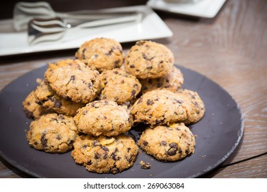 Cookies with raisins on wooden table. Shallow DOF and lightly toned.