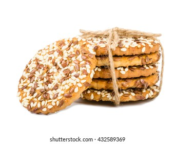 Cookies with seeds and linen rope isolated on white background