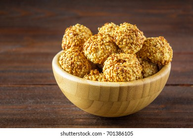 cookies with sesame seeds on a wooden table