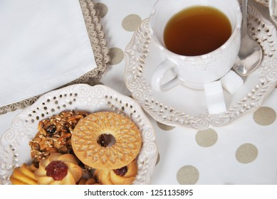 cookies with sugar with seeds, marmalade and caramel, baked at home and tea in a retro cup with free space for text