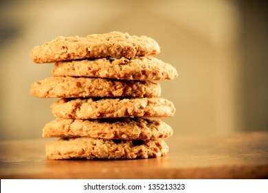 Cookies - This is a stack of cookies shot on a wooden table top. Shot with a shallow depth of field and a warm retro color tone.