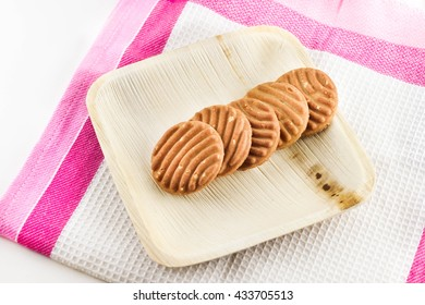 Cookies in wooden plate isolate on white background