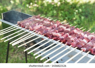 Cooking Abruzzesi arrosticini close up