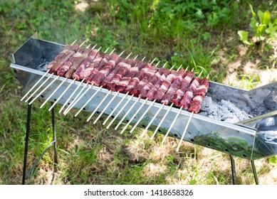 Cooking Abruzzesi arrosticini closeup view