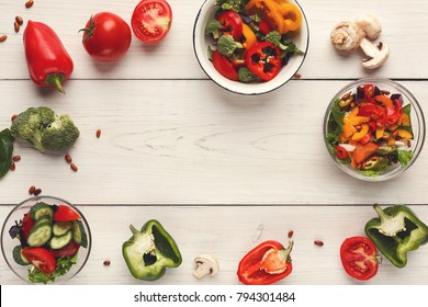 Cooking assorted vegetable salads on white wood top view. Fresh organic snack for vegetarian party food table, copy space. Mockup for menu, recipe or culinary classes