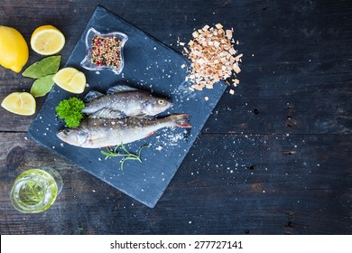Cooking background, fish on the blackboard, top view