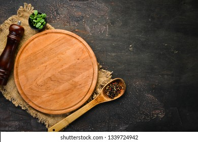 Cooking banner. Kitchen board, spices and cutlery. Top view. Free space for your text. Rustic style.