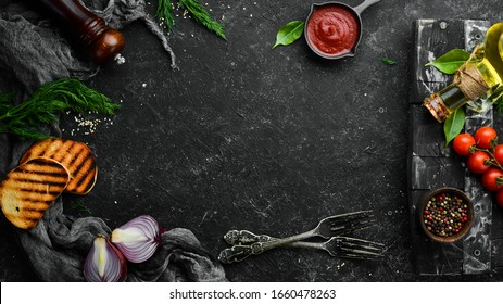 Cooking banner. Vegetables and spices on a black background. Free space for your text. Rustic style.