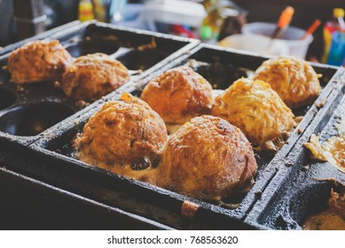 cooking big takoyaki