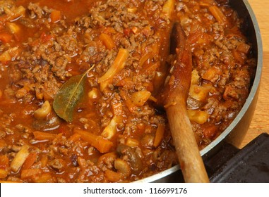 Cooking bolognese sauce in open saucepan