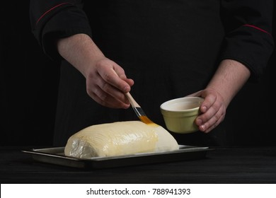 Cooking bread by chef male hands on black food background concept. Copy text recipe.