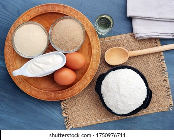 Cooking breaded farmers cheese dumplings with ingredients on a rustic table setting