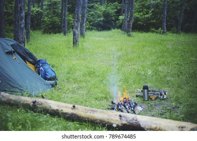 Cooking breakfast on a campfire at a summer camp.