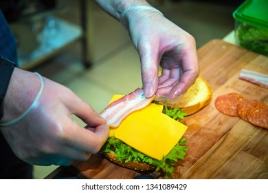 Cooking Burger with onion, cheese and bacon