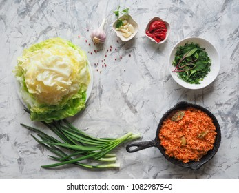 Cooking cabbage leaves stuffed with rice and vegetables. Vegetarian cuisine.