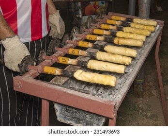 Cooking cabure, a traditional South American food cooked over coals, made of cassava flour and cheese