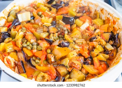 Cooking caponata in a large frying pan