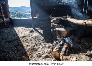 Cooking in cast-iron cauldron. Breakfast in the mountains.