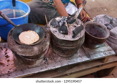 Cooking chapattis over charcoal fire  at a weekly market on Inle Lake,  Myanmar (Burma)