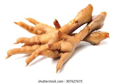 Cooking chicken feet on white background