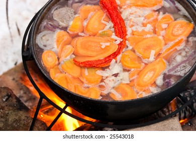 Cooking Chorba soup in cauldron  on fire