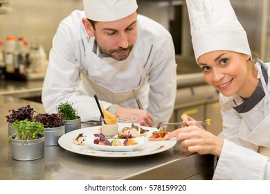 cooking class,culinary and food concept- Female cook cooking in kitchen