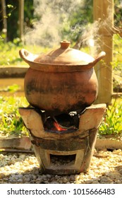 Cooking in the clay pot on fire In the countryside of Thailand