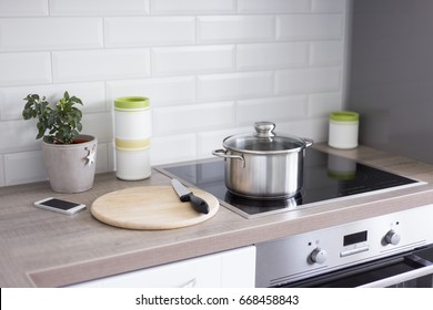 cooking concept - close up of kitchen table with modern equipment