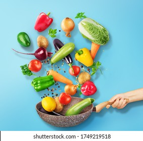Cooking concept. Vegetables and bacon are falling on a pan isolated on white background. Healthy food.