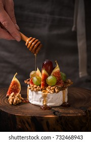 Cooking dessert with camembert cheese, figs and honey