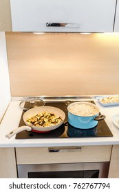 Cooking dinner with turkish manti and fried vegetables on a modern induction cooker