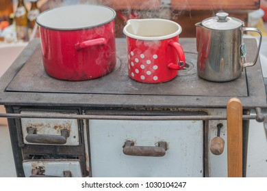 cooking dishes and heating water on retro wood fueled stove, shallow focus