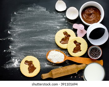 Cooking Easter biscuits with ingredients on black background empty space for text top view